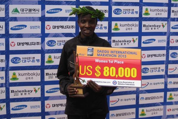 Margerat Akai after winning at the 2013 Daegu International Marathon (Robert Wagner / organisers)