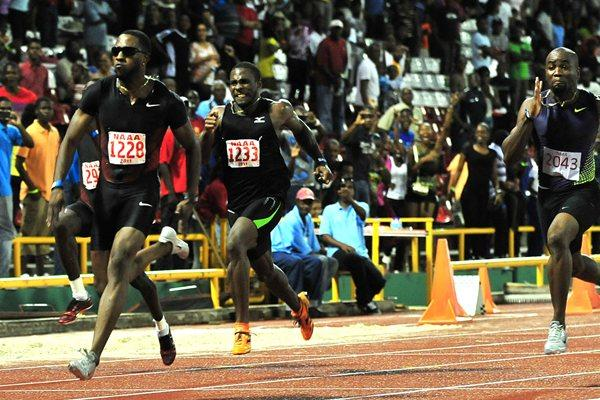 Richard Thompson (l) bolts to victory in the National Championship men's 100m, in Port of Spain. Thompson clocked a 9.85 national record. (Stephen Doobay / Trinidad Express)