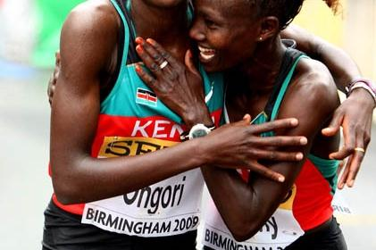 World Half Marathon champion Mary Keitany (R) congratulates team mate Philes Ongori on her silver medal winning performance (Getty Images)