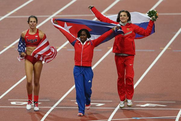Gold medallist Jennifer Suhr, silver medallist Yarisley Silva and Elena Isinbaeva celebrate after the Pole Vault final at the London 2012 Olympics (Getty Images)