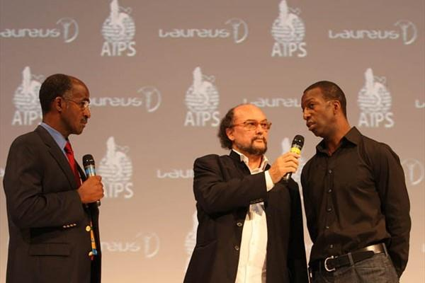 """(L-R) Jamaican Head Coach Don Quarrie, AIPS President Gianni Merlo and Laureus Academy member Michael Johnson at the Laureus-AIPS Olympic Press Conference to celebrate the """"Spirit of Sport' (AIPS)"""