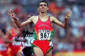 Hicham El Guerrouj winning the 1500m at the 1999 IAAF World Championships (Allsport)