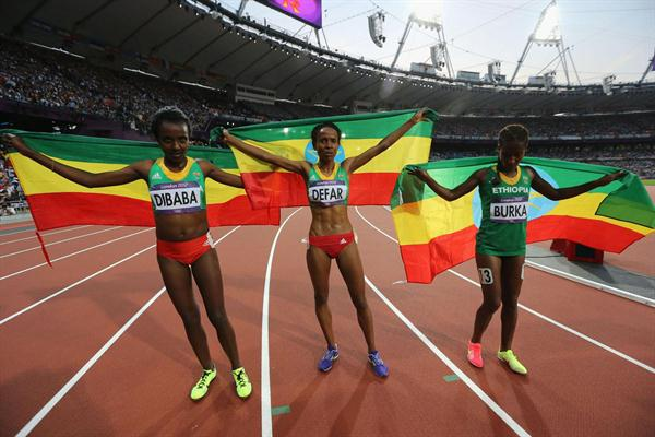 Meseret Defar (C) of Ethiopia celebrates with Tirunesh Dibaba (L) of Ethiopia and Gelete Burka of Ethiopia after winning gold in the Women's 5000m Final on Day 14 of the London 2012 Olympic Games at Olympic Stadium on August 10, 2012  (Getty Images)