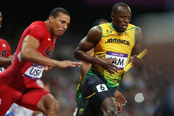 Usain Bolt of Jamaica receives the relay baton from Yohan Blake of Jamaica next to Ryan Bailey of the United States during the Men's 4 x 100m Relay Final  of the London 2012 Olympic Games on August 11, 2012  (Getty Images)