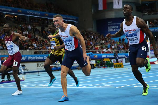 Richard Kilty crosses the finish line to win gold at Sopot 2014 ()