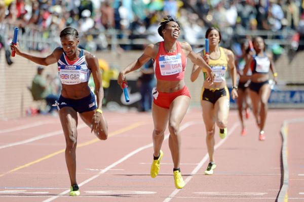 Francena McCorory out-leans Perri Shakes-Drayton to take the 4x400m win at the Penn Relays (Kirby Lee)