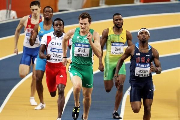 David Gillick of Ireland and Bershawn Jackson of the USA compete in the mens 400m semi-final at the 13th IAAF World Indoor Championships in Athletics (Getty Images)
