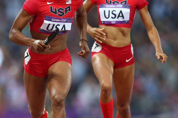 Francena McCorory of the United States receives the relay baton from Allyson Felix of the United States on their way to winning gold in the Women's 4 x 400m Relay Final of the London 2012 Olympic Games on August 11, 2012  (Getty Images)
