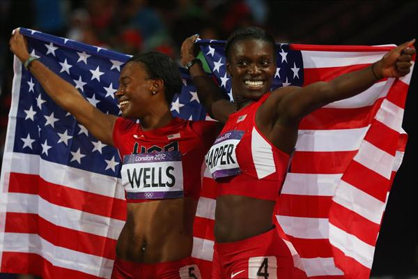 Bronze medalist Kellie Wells and silver medalist Dawn Harper of the United States celebrate after the Women's 100m Hurdles Final on Day 11 of the London 2012 Olympic Games on 7 August 2012 (Getty Images)