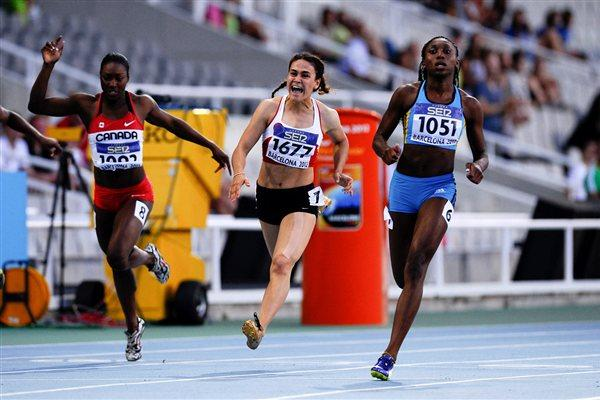 Anthonique Strachan (L) of Bahamas wins the Women's 100 metres Final on the day two of the 14th IAAF World Junior Championships in Barcelona 2012 (Getty Images)