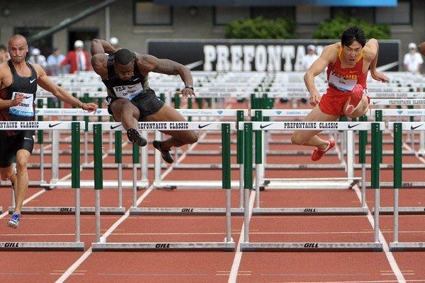 David Oliver and Liu Xiang do battle in Eugene (Kirby Lee)