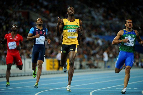 Usain Bolt of Jamaica celebrates winning his men's 200 metres semi final ahead of Bruno de Barros of Brazil during day seven  (Getty Images)