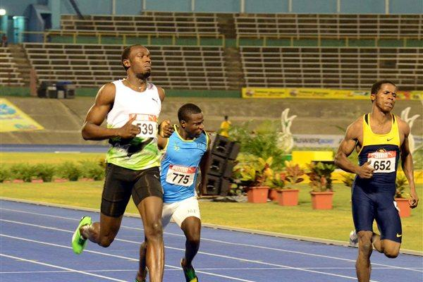 Usain Bolt easing through the first round of the 100m at the Jamaican Trials in Kingston (Anthony Foster)