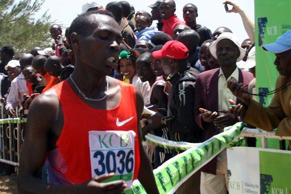 Bedan Karioki crosses the finish line to win gold in the 12 KM Senior Men category at the 2012 KCB National Cross Country Championships  (Credit Ogilvy Communications)