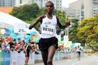 Edith Masai taking the Singapore Marathon title (Pat Butcher)