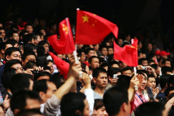 Chinese fans attend the Olympic race walk test event in Beijing (Getty Images)