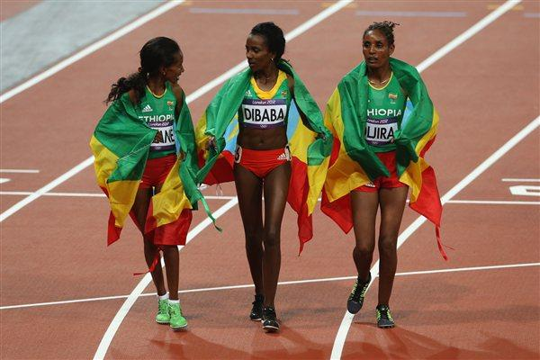 Gold medalist Tirunesh Dibaba of Ethiopia (C) celebrates with Werknesh Kidane (L) and Beleynesh Oljira of Ethiopia (R) after the Women's 10,000m Final on Day 7 of the London 2012 Olympic Games on August 3, 2012  (Getty Images)