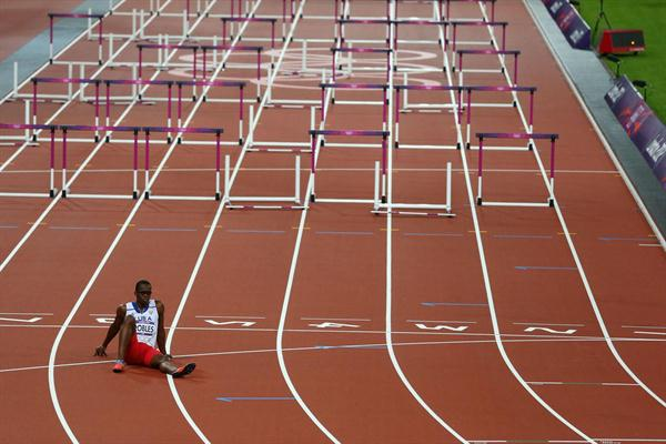 Dayron Robles of Cuba sits on the track, disappointed after pulling up injured in the Men's 110m Hurdles Final on Day 12 of the London 2012 Olympic Games on 8 August 2012 (Getty Images)