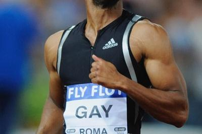 Tyson Gay wins an epic 100m clash against Asafa Powell, equalling the American record of 9.77 (Getty Images)