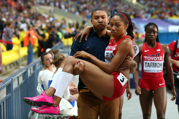 Allyson Felix is carried off the track by her brother at the 2013 IAAF World Championships in Moscow (Getty Images)