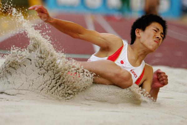 Yasumichi Konishi of Japan on his way to gold in the Long Jump final (Getty Images)