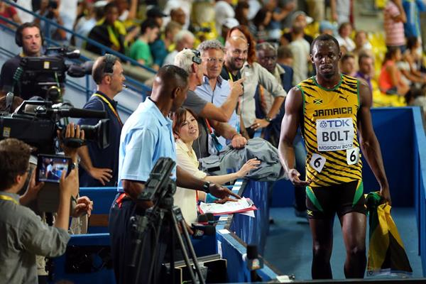 Usain Bolt walks through the mixed zone at the 2013 IAAF World Championships in Moscow (Getty Images)