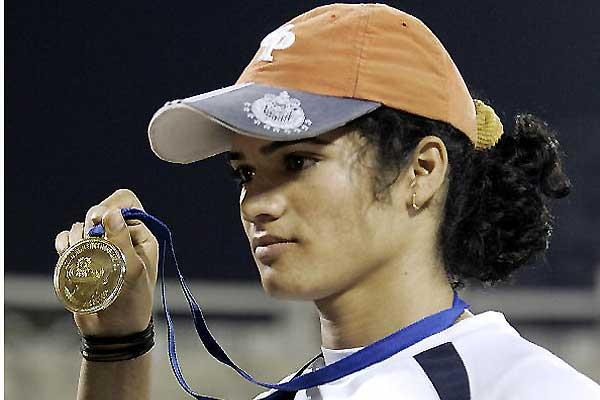 Pinki Parmanik of India shows off one of her two Asian GP medals in Bangalore, India (AFP / Getty Images)
