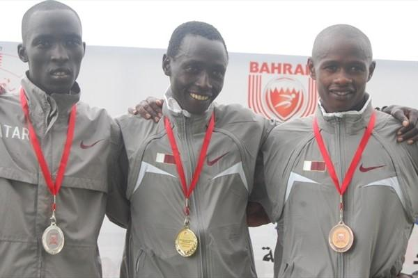 The Qatari men's podium at the Asian Cross Country Championships - Essa Ismail Rahed, Ahmed Hassan Abdullah, Felix Kikwai Kibore (Elshadai Negash)