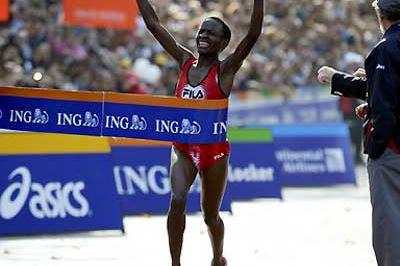 Margaret Okayo breaks the tape at the 2003 New York Marathon (Victah Sailer)
