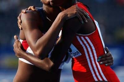 Takecia Jameson of USA wins gold and Janeil Bellille of Trinidad and Tobago silver in the final of the 400m Hurdles (Getty Images)