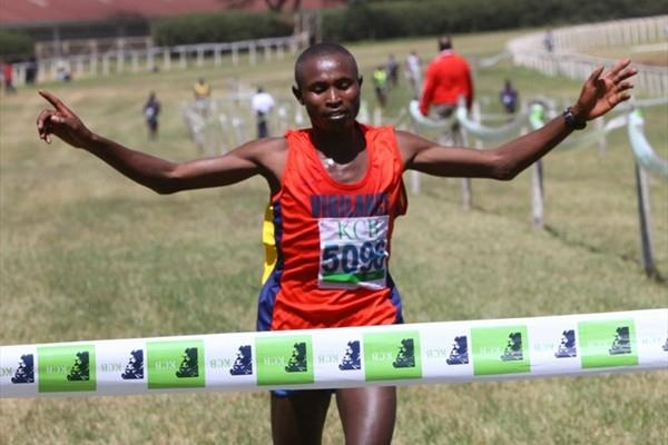 Geoffrey Mutai crosses the line for victory in the men's 12km race at 2011 Kenya Police Interdivisional Cross Country Championships (Ignatius Kemboi)