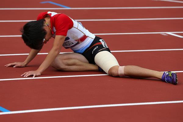 Takayuki Kishimoto pulls up injured at the London 2012 Olympics (Getty Images)