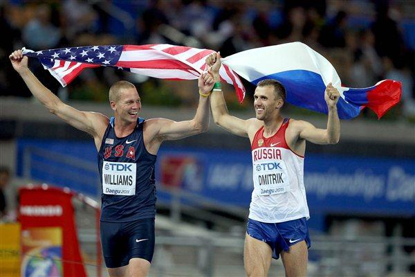 Jesse Williams (L) of United States celebrates next to Aleksey Dmitrik of Russia after the men's high jump final during day six  (Getty Images)