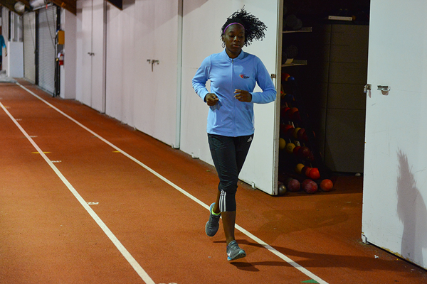 Maribel Caicedo warms up for a day of training with Ashton Eaton (Phil Johnson / TrackTown USA)