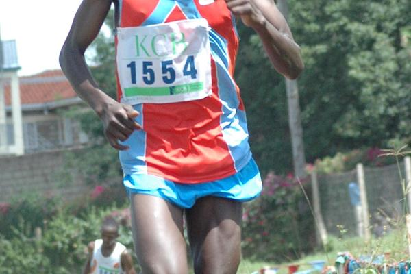 Soldier William Chebon on the way to winning the senior men's 12-kilometre race at the third Athletics Kenya cross country champions meeting in Meru, eastern Kenya (Elias Makori)