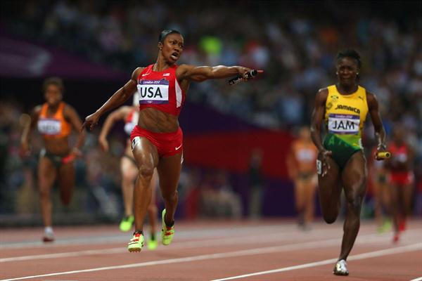 Carmelita Jeter of the United States celebrates winning gold ahead of Kerron Stewart of Jamaica and set a new World Record in the Women's 4 x 100m Relay Final  of the London 2012 Olympic Games on 10 August 2012 (Getty Images)