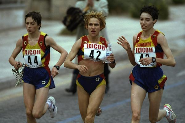 Lidia Simon #44, Anuta Catuna #42 and Cristina Pomacu #43, all of Romania running during the 1995 IAAF World Marathon Cup in Athens, Greece (Getty Images)