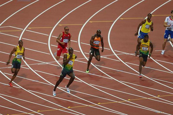 Usain Bolt of Jamaica exits the bend ahead of (L-R) Warren Weir of Jamaica, Wallace Spearmon of the United States, Churandy Martina of Netherlands, Yohan Blake of Jamaica, Alex Quinonez of Ecuador and Christophe Lemaitre of France on his way to winning gold in the Men's 200m Final of the London 2012 Olympic Games on August 9, 2012  (Getty Images)