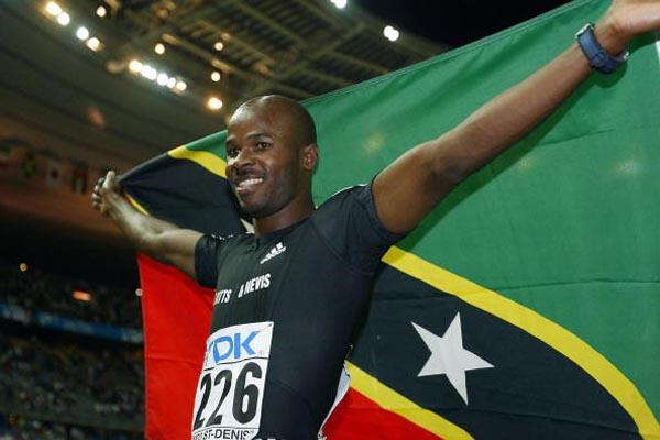 Kim Collins celebrates winning the 100m final (Getty Images)