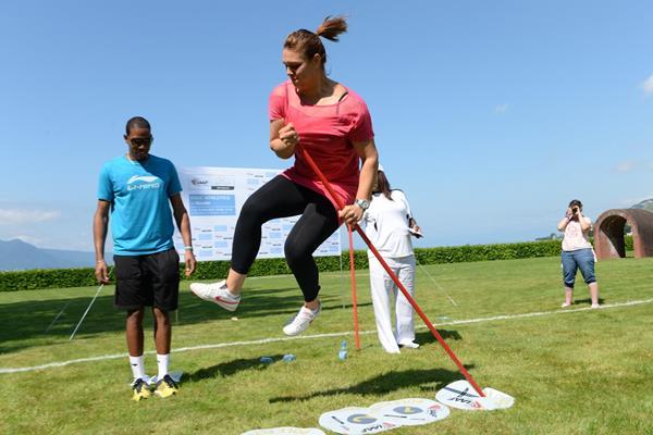 Sandra Perkovic has a go at 'pole flying' at the IAAF / Nestlé Kids' Athletics demonstration in Vevey, Switzerland (Jiro Mochizuki)