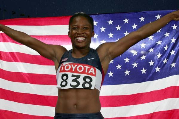 Lauryn Williams celebrates winning the women's 100m gold (Getty Images)