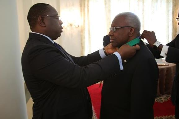 President of Senegal Macky Sall decorates IAAF President Lamine Diack with the Commander of the Order of the Golden Lion (IAAF)