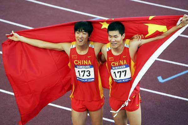 Liu Xiang with Shi Dongpeng at Asian Games (Getty Images)