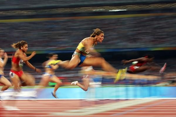 Susanna Kallur and Josphine Onyia in action in the heat of the women's 100m hurdles (Getty Images)