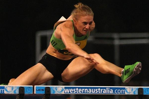 Sally Pearson on her way to winning the 100m Hurdles, one of three events she won in Perth (Getty Images)