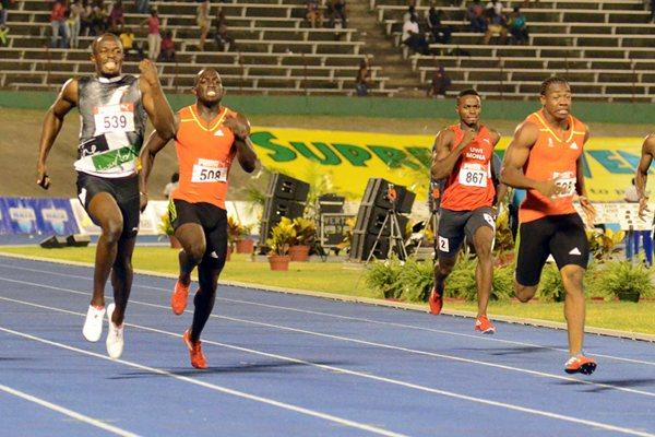 Yohan Blake (r) en route to victory over Usain Bolt in the Jamaican trials 200m (Anthony Foster)