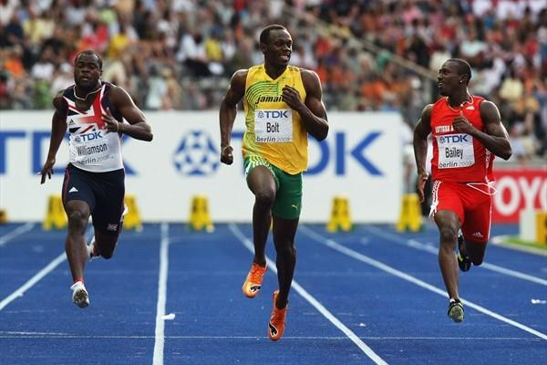 Training partners Usain Bolt and Daniel Bailey share a smile as they both qualify easily for the 100m semi-finals (Getty Images)