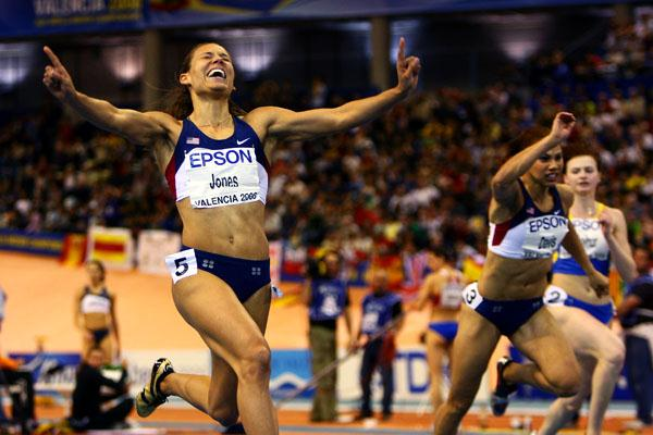 Lolo Jones celebrates as she crosses the finish line in the women's 60m hurdles (Getty Images)