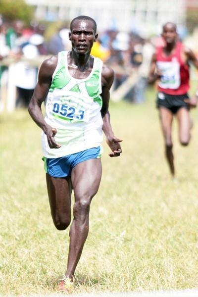 Joel Kemboi Kimurer sprints to the finish line to win the 12-kilometre race at the 2009 Kenya Police National Cross Country Championships at the Ngong Racecourse in Nairobi. (Elias Makori)