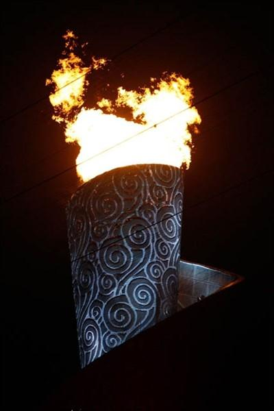 The Olympic flame burns bright above the Olympic Stadium, Beijing (Getty Images)